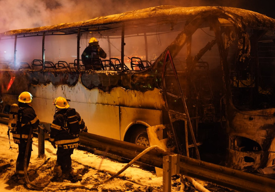 Israeli bus set ablaze in West Bank as ambulance cuts pending