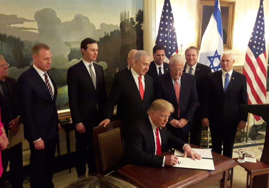 U.S. President Donald Trump signs a document recognizing Israeli control over the Golan Heights