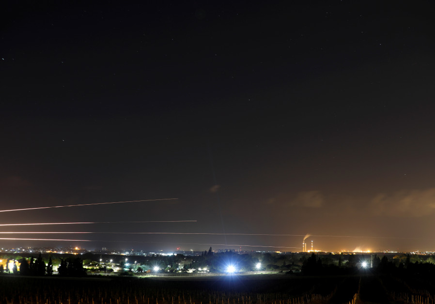 Streaks of light are pictured as rockets are launched from the Gaza Strip towards Israel, as seen fr