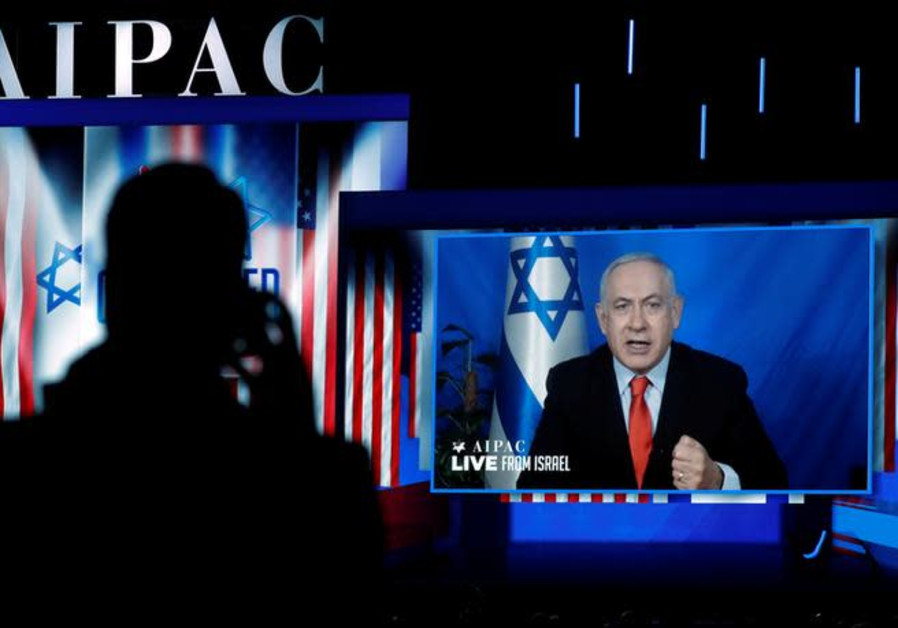 Speaking via satellite feed from Israel, Israeli Prime Minister Benjamin Netanyahu addresses AIPAC i