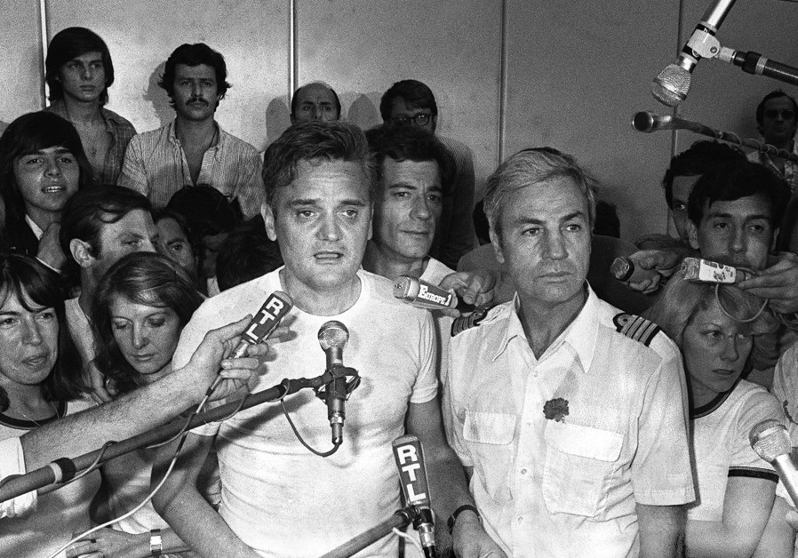 Michel Bacos (R) speaks to the media in 1976