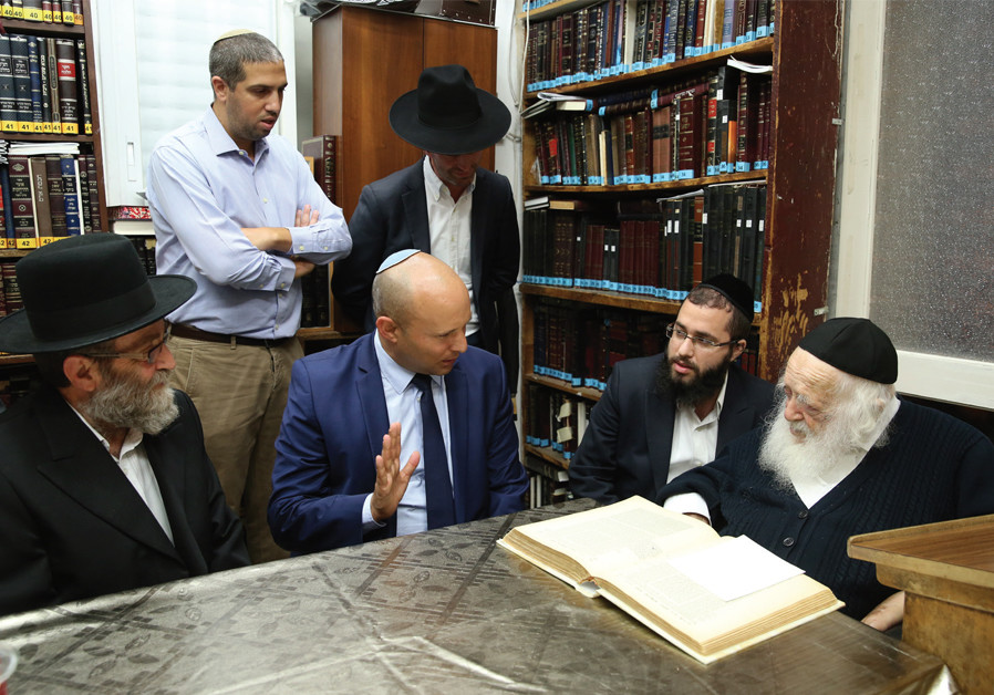 Tal Gan Zvi stands behind Naftali Bennett during a visit to Rabbi Chaim Kanievsky (credit: Flash90/ Yaacov Cohen)