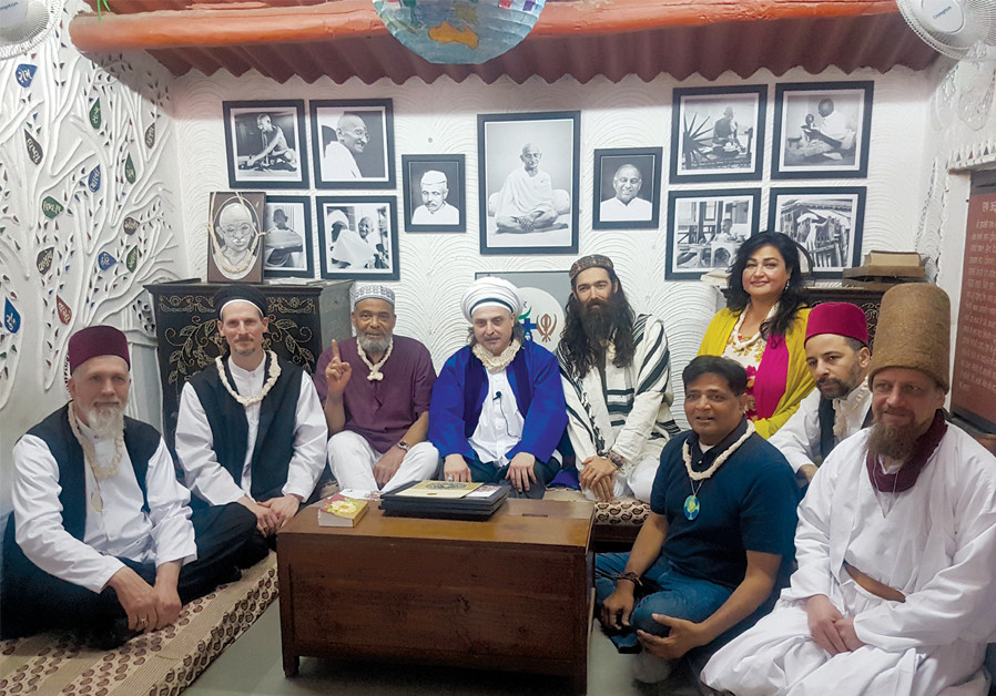 THE AMERICAN Imam Faaruuq and Israeli Rabbi Stadlan are joined by Sheikh Esref Efendi (in white turban and blue vest), a Turkish Sufi leader from Berlin, at the Gandhi Ashram in India. (Manav Sadhna)