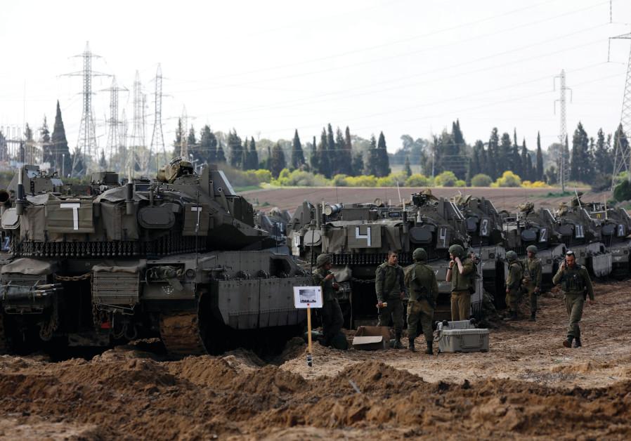 TANKS DEPLOYED near the Gaza border