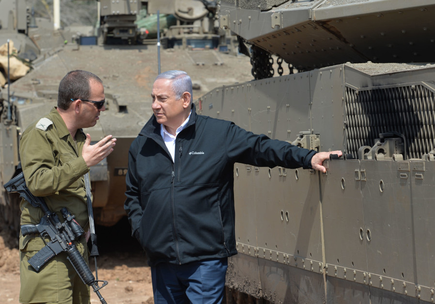 Prime Minister Benjamin Netanyahu receives a briefing from the commander of the 162nd Division durin