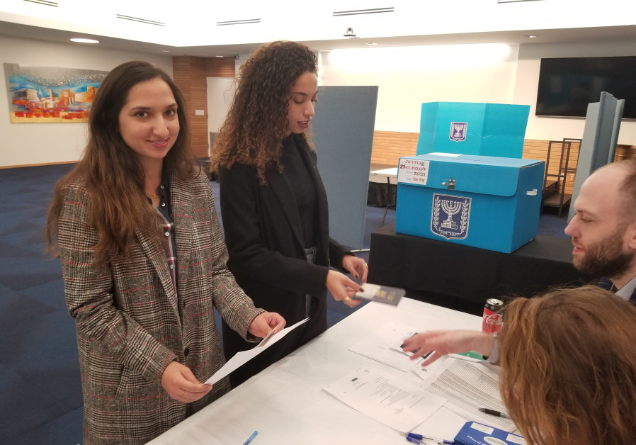 Adi and Yuval Peretz vote in the Israeli embassy in Washington, DC
