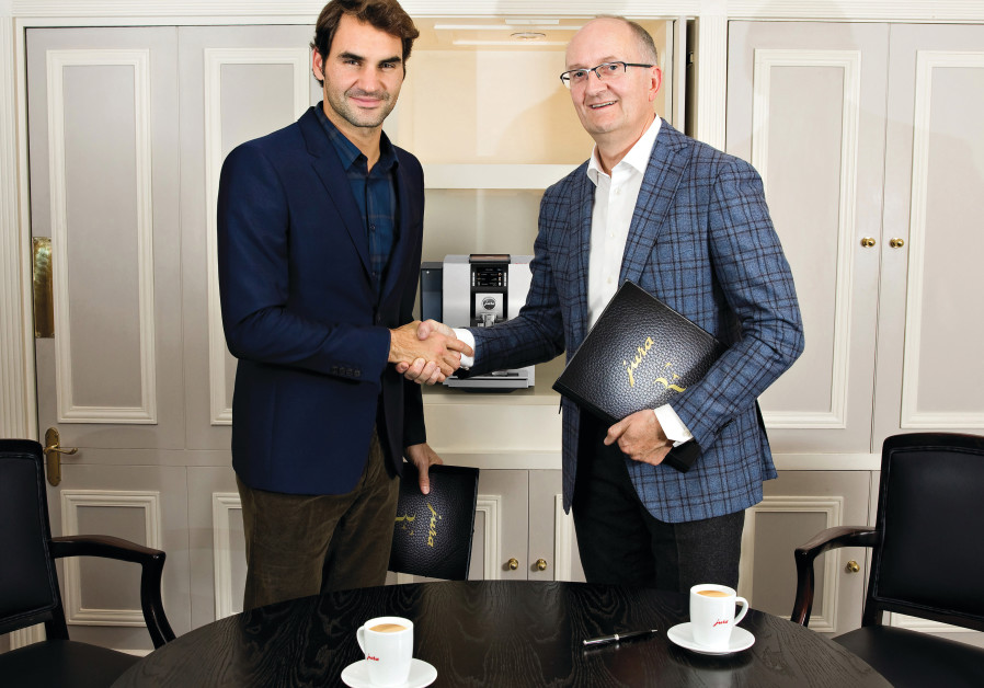 ROGER FEDERER and Jura CEO Emanuel Probst after the signing of the contract