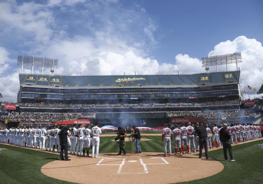 Mar 28, 2019; Oakland, CA, USA; Oakland Athletics and Los Angeles Angels players