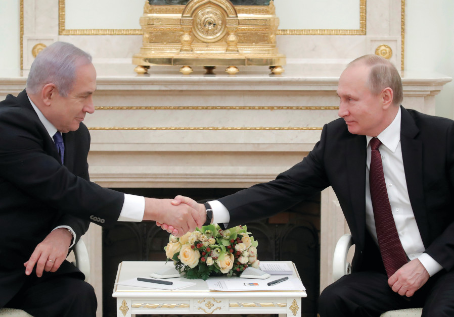 RUSSIAN PRESIDENT Vladimir Putin shakes hands with Prime Minister Benjamin Netanyahu during a meetin