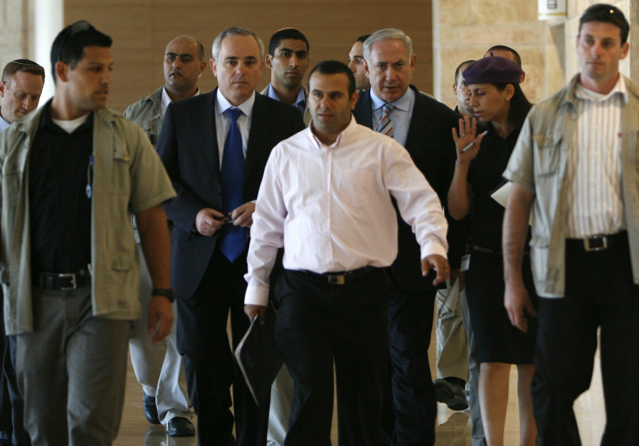 Leading the charge: Shalom Shlomo walks ahead of Prime Minister Benjamin Netanyahu and Energy Minister Yuval Steinitz (credit: Miriam Alster/Flash90)