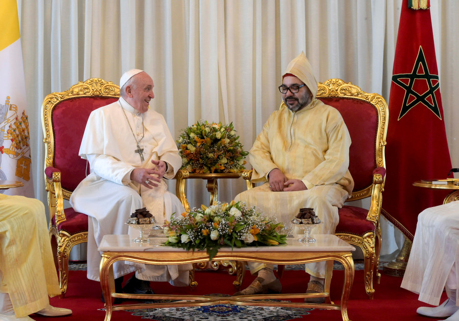 Pope Francis is received by Morocco's King Mohammed VI upon his arrival in the capital Rabat, Morocc