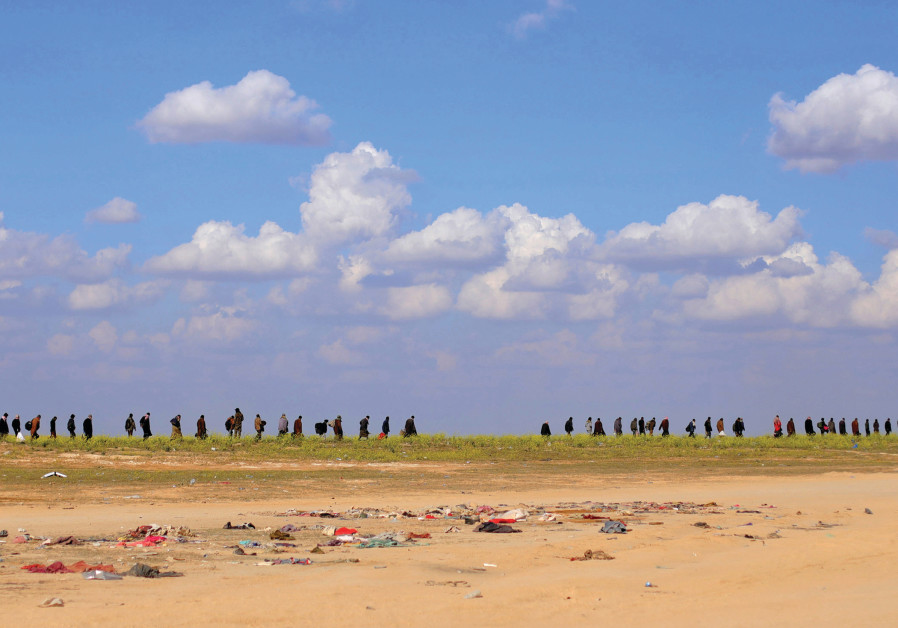 ISIS MEMBERS flee Baghouz. Now it's time to put them on trial. (Reuters)
