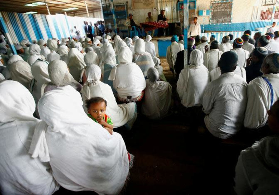 Members of the Falash Mura Jewish Ethiopian community attend a prayer service at the HaTikvah Synago