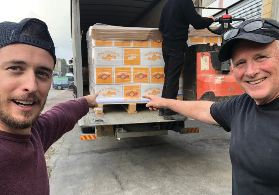 MATT NEILSON (left) and Denny Neilson with the first shipment of ciders and lemonades