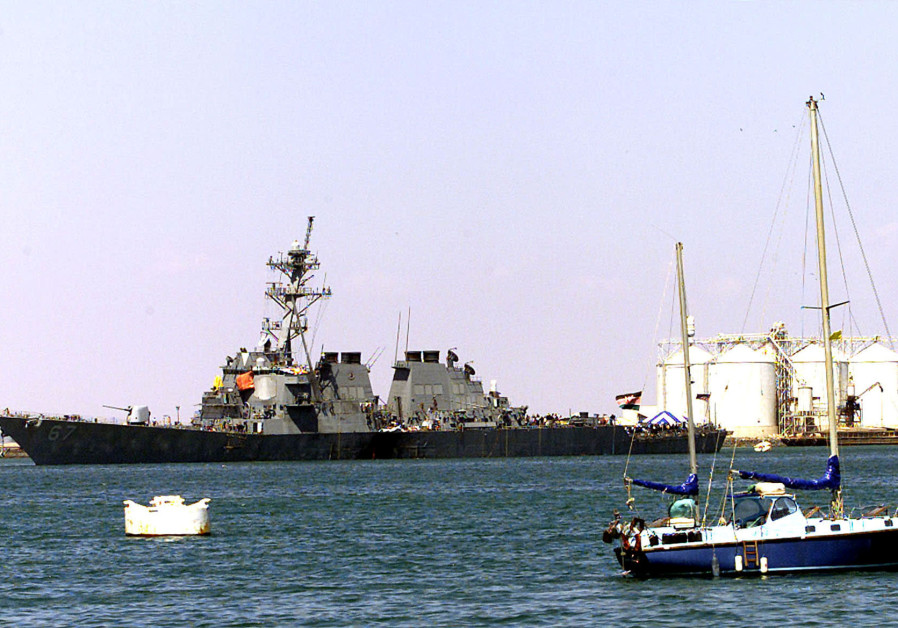 THE U.S NAVY WARSHIP, COLE, FLOATS IN THE IN THE PORT OF ADEN.