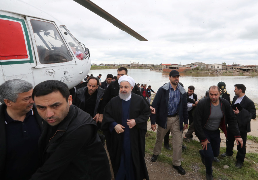 Iranian President Hassan Rouhani is seen during his visit after flooding in Golestan province