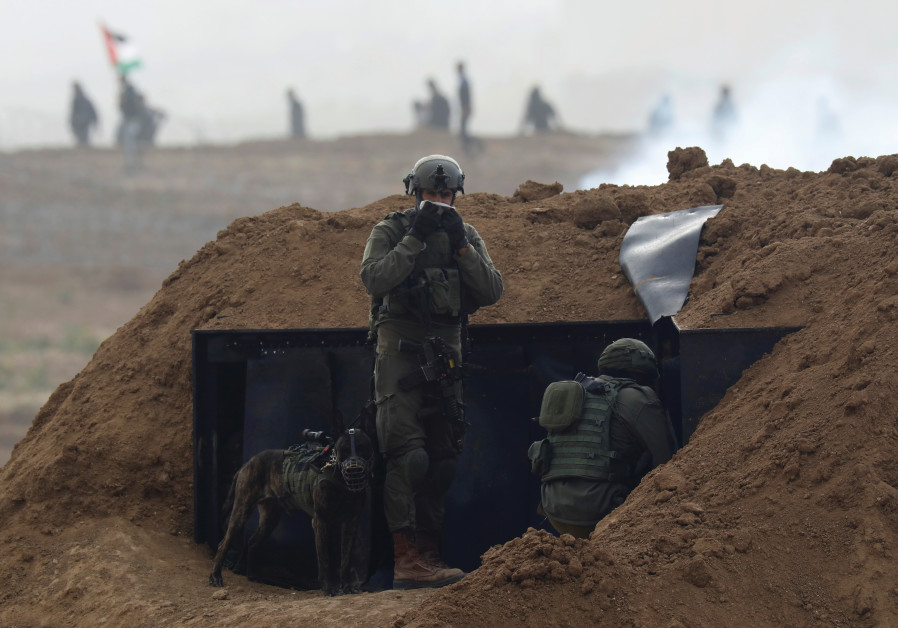 ISRAELI SOLDIERS conducting a routine mission. (Reuters)