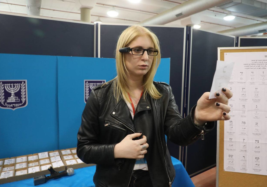 A visually-impaired OrCam user demonstrates using the technology to vote