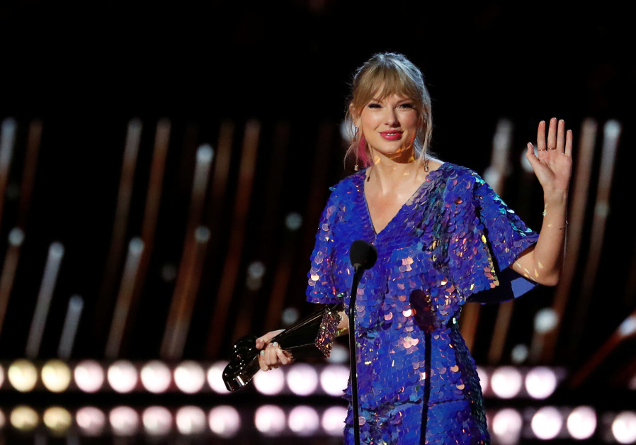 Singer Taylor Swift receives the Tour of the Year award during the iHeartRadio Music Awards in Los A