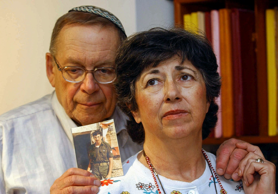 Miriam and Yonah Baumel hold a picture of their son Zachary Baumel, who was taken prisoner of war in