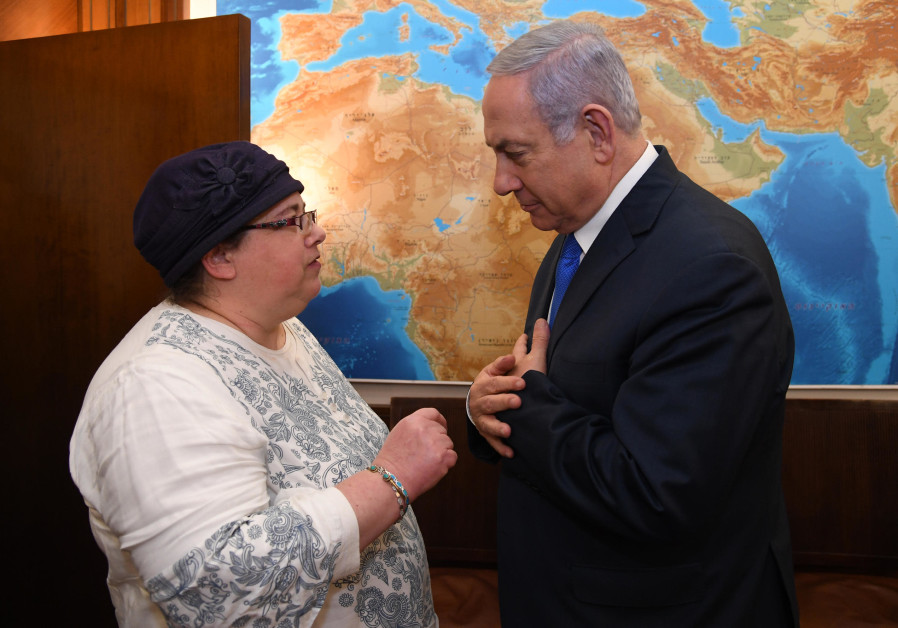 Prime Minister Benjamin Netanyahu and Osna Baumel, sister of Zachary Baumel