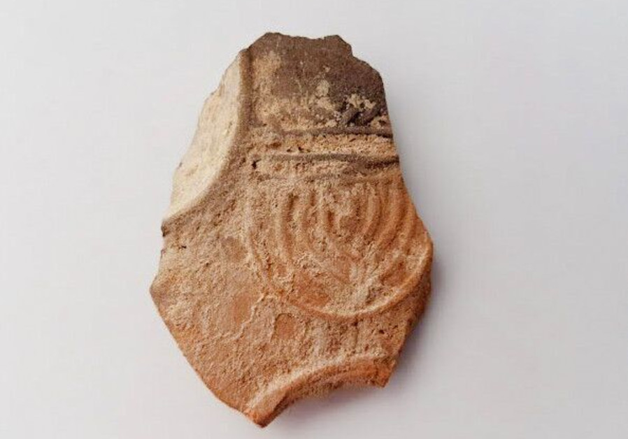 Second Temple era menorah depicted on candle fragment in Beersheba