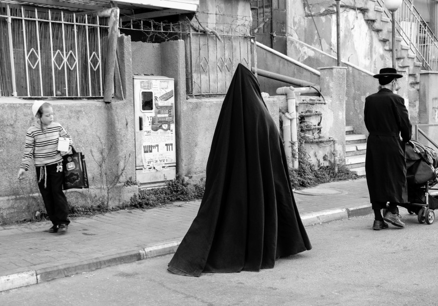 A Jewish women in Jerusalem's Mea She'arim, neighborhood, 2012. A relatively new phenomenon, the overwhelming majority of Jewish women do not choose to dress in full-length shawls (Yael Gadot)