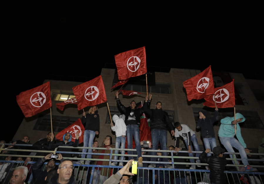 Palestinians hold Popular Front for the Liberation of Palestine (PFLP) flags, December 23, 2013