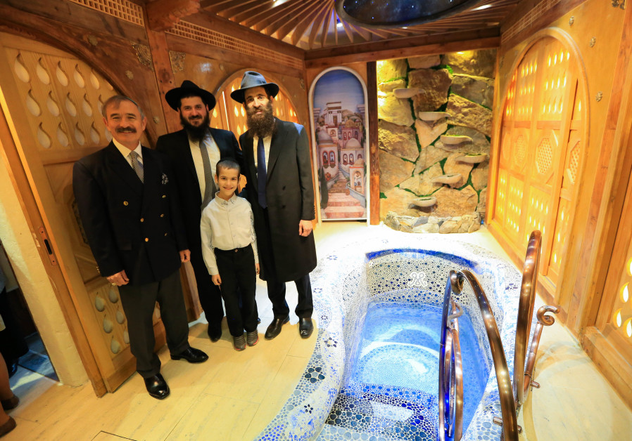 Rabbi Osher Litzman and close ones stand beside the new $850,000 mikvah in South Korea, 2019.
