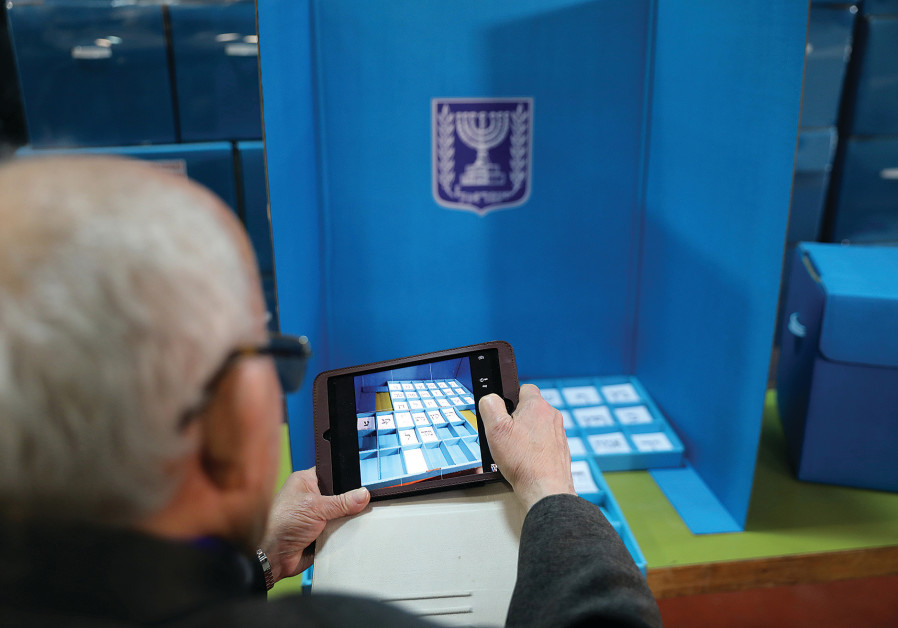 A JOURNALIST takes a photograph of old ballot slips during a briefing at the Central Election Commit
