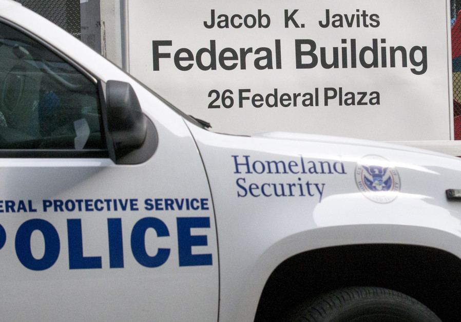 A U.S. Pat. Homeland Security Protective Service truck parks outside the Jacob Javits Federal office