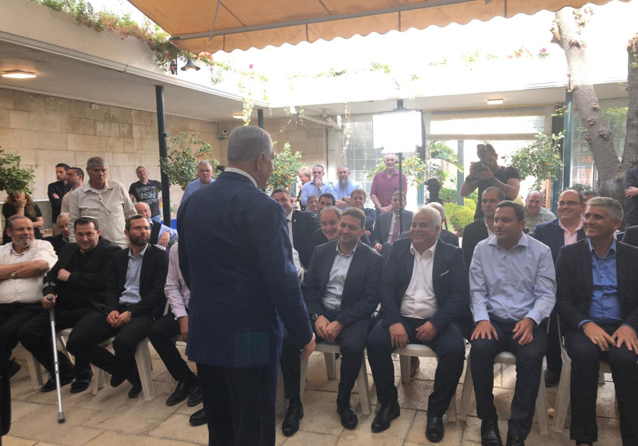 Prime Minister Benjamin Netanyahu at a meeting with West Bank community heads