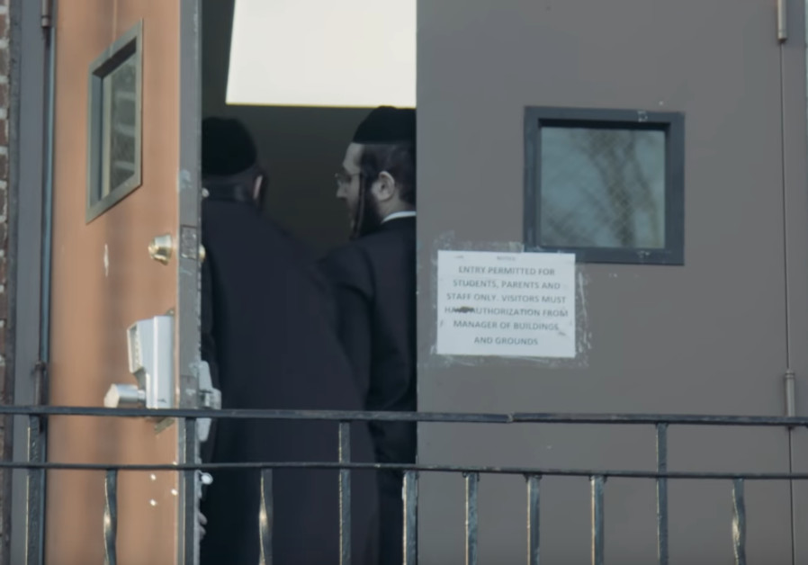 Youtube screenshot of Satmar yeshiva in Chabad shul in Seagate, NY