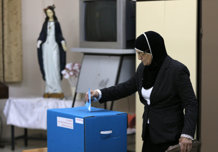 An Israeli Arab casts her ballot at a polling station in the northern town of Reineh, in 2015