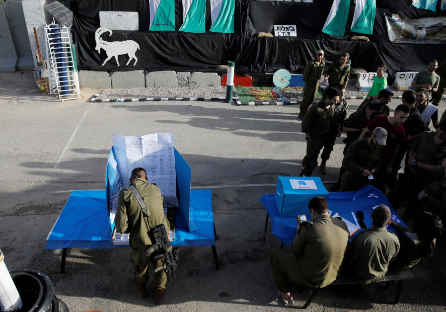 A general view shows Israeli soldiers voting at a mobile voting booth