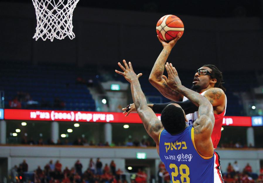 HAPOEL JERUSALEM'S Amar'e Stoudemire shoots over Maccabi Tel Aviv's Tarik Black