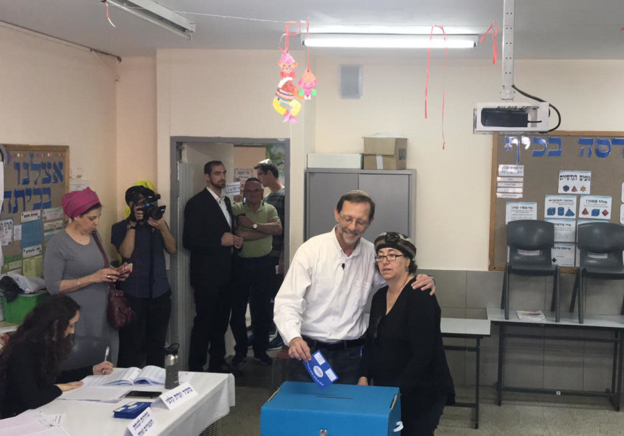Moshe Feiglin voting his wife