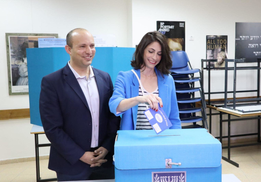 Naftali Bennett voting with his wife, Gila