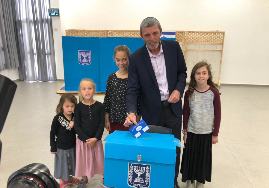 Rafi Peretz votes with four of his children in southern Israel. (Courtesy)