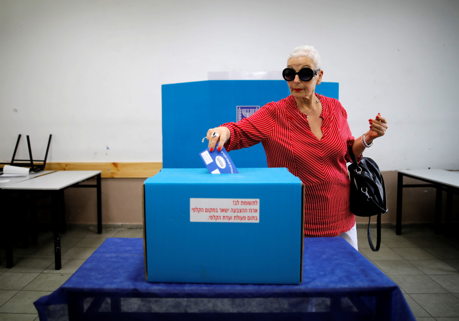 A woman casts her ballot at a polling station in Tel Aviv, April 9, 2019