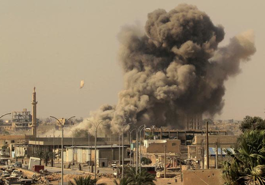 Smoke rises after an air strike during fighting between members of the Syrian Democratic Forces
