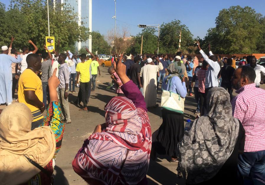 Sudanese demonstrators chant slogans during a protest demanding Sudanese President Omar Al-Bashir