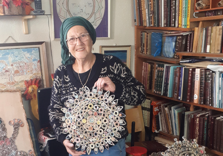 TOVAH SHOWS off her more intricate, indoor, rolled-newspaper pieces. (Courtesy)