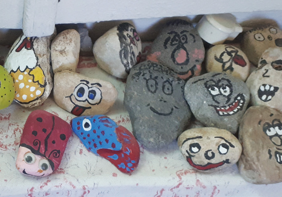 SIMPLE STONES transform into funny faces. (Courtesy)