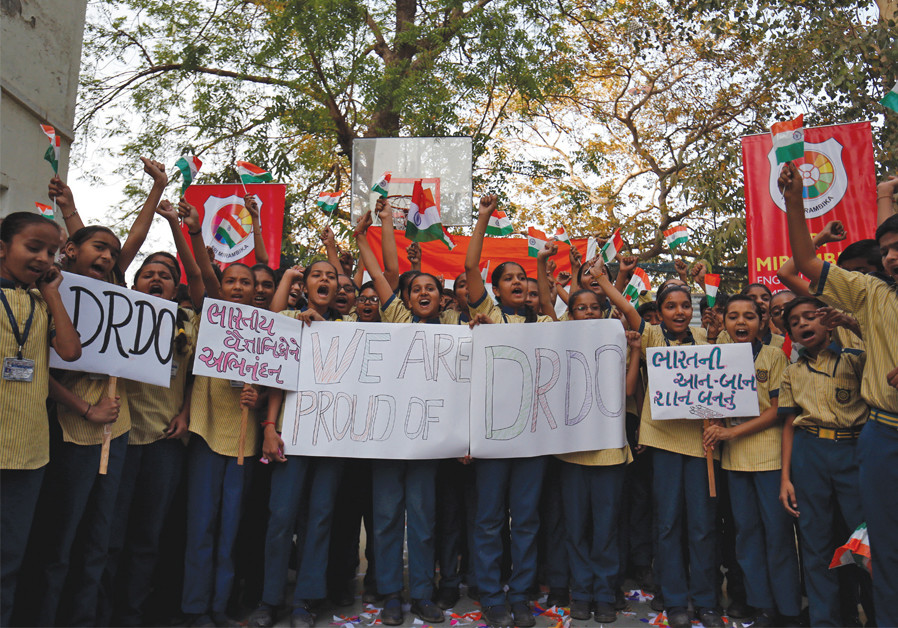 STUDENTS CHEER as they hold flags and placards to celebrate after India shot down one of its satellites in space with an anti-satellite missile in a test, in Ahmedabad, India, on March 27. (Reuters)