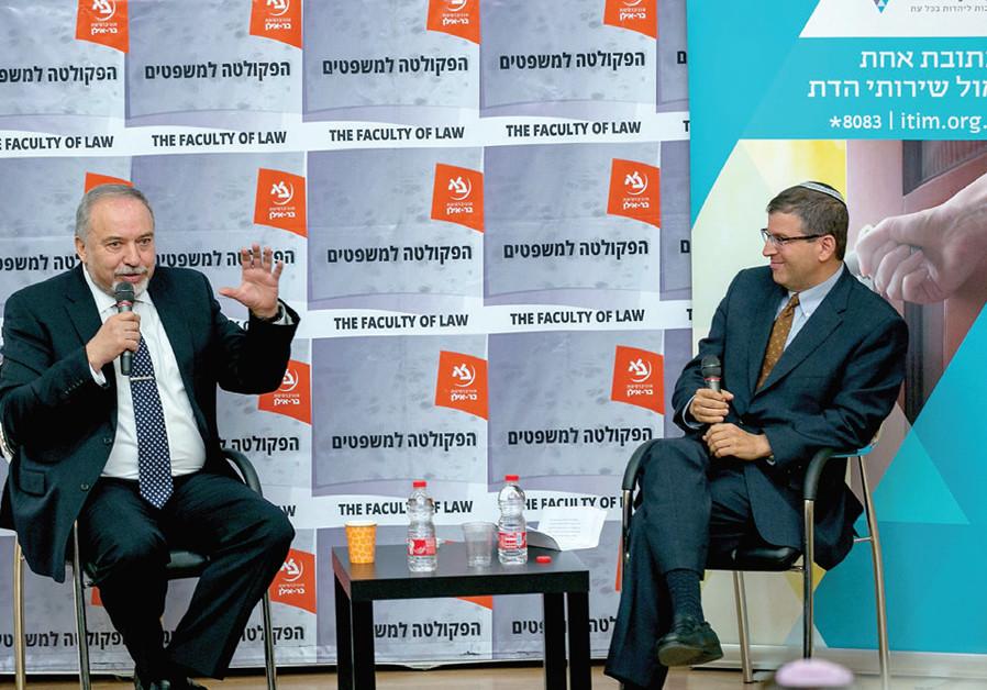 Rabbi Seth Farber interviews Avigdor Liberman at an ITIM Town Hall Meeting recently. (MAXIM DINSHTEIN)