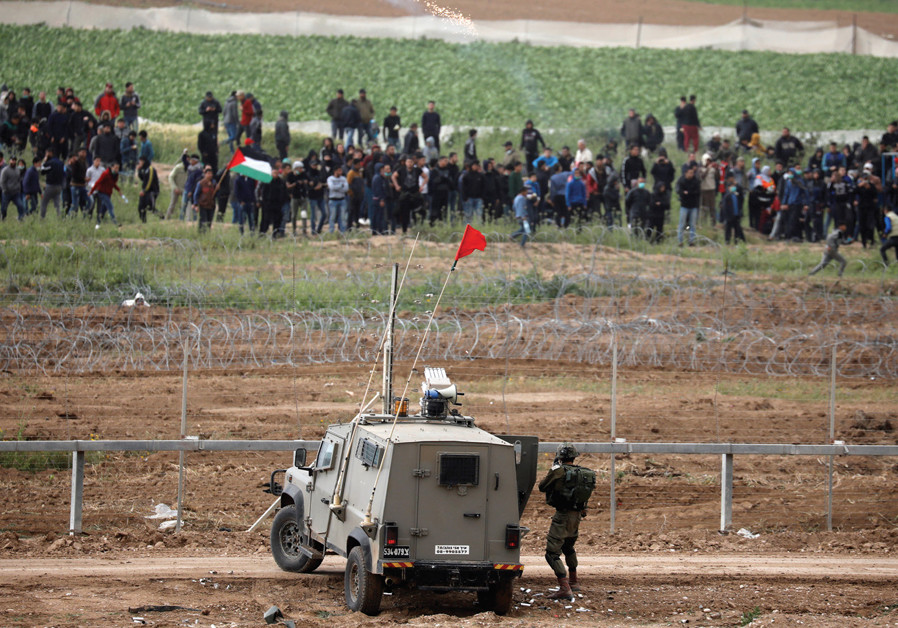 Palestinians injured in Gaza protests, thousands gather along border fence