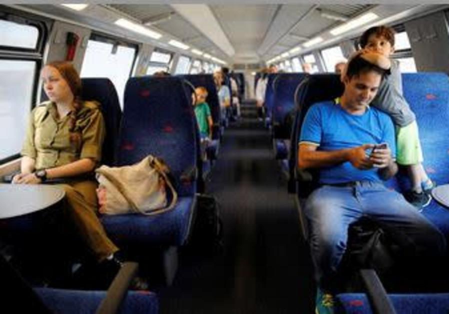 Passengers travel on Israel's new high-speed rail line from Ben Gurion International Airport to Jeru