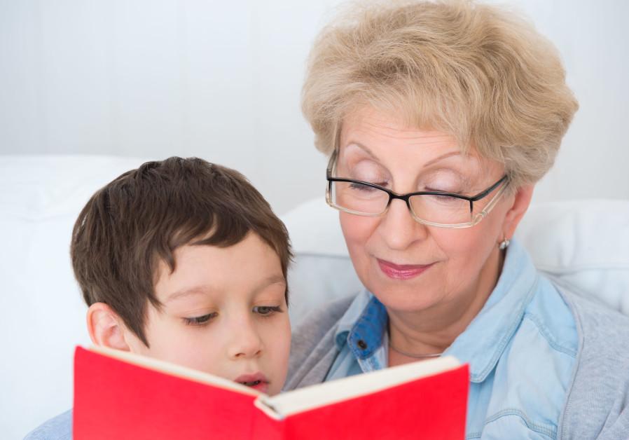 A bubbie reads to her grandchild (illustrative)