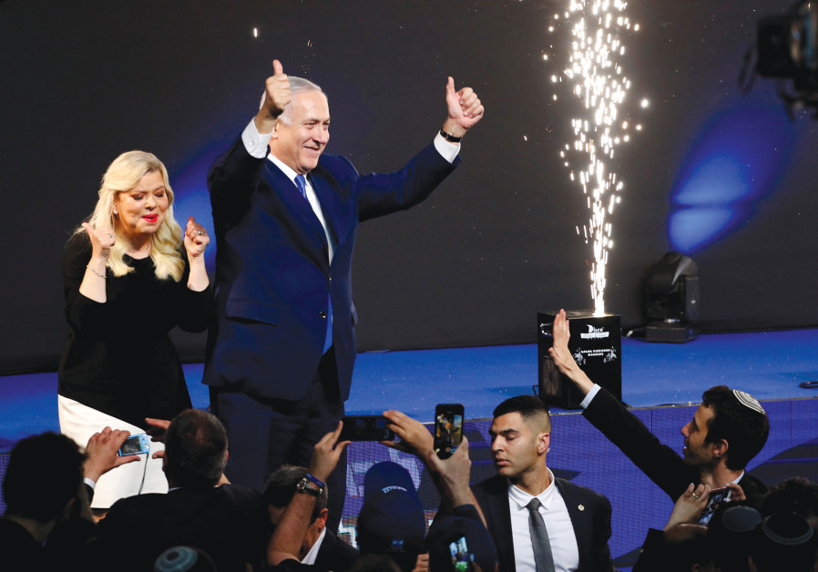 PRIME MINISTER Benjamin Netanyahu and his wife, Sara, celebrate at Likud Party headquarters